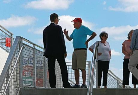 Owner John Henry talked with a fan in the JetBlue Park stands after talking with the media for a long time about all things Red Sox on Wednesday.
